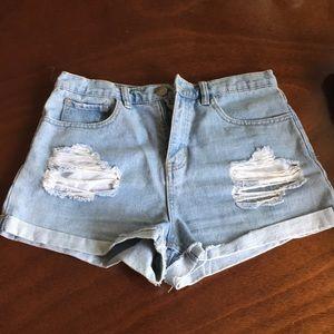 Distressed high rise denim shorts